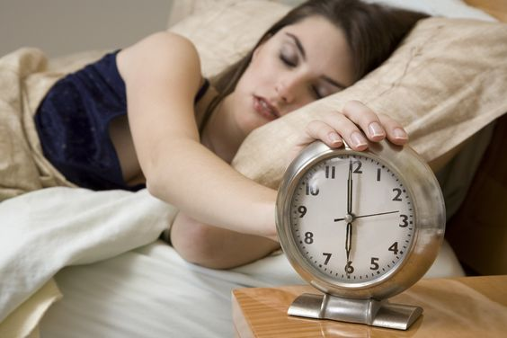 Model Release 365 Woman in early waking up to an alarm clock